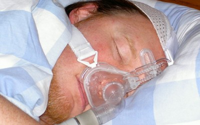 Patient using a CPAP mask, covering only nose