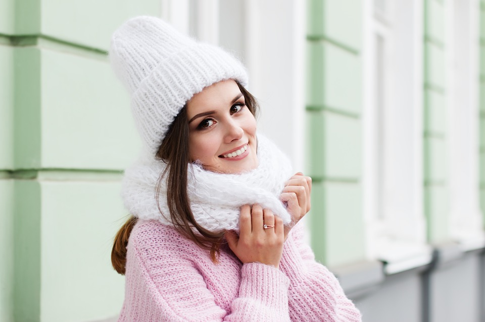 happy woman with knitted scarf